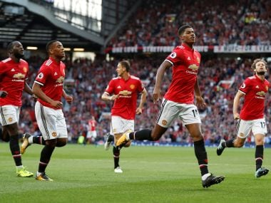 Manchester United's Marcus Rashford celebrates scoring their first goal with teammates. Reuters