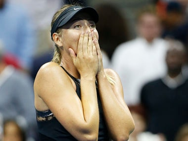 Maria Sharapova reacts after defeating Simona Halep 6-4, 4-6, 6-3 in US Open. AP