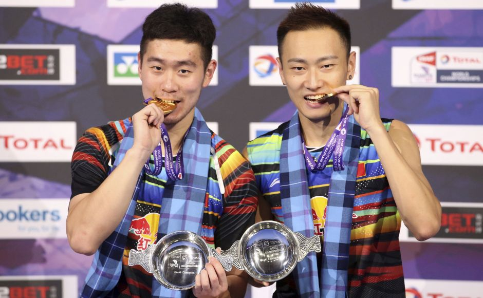 China's Liu Cheng and Zhang Nan defeated Indonesia's Mohammad Ahsan and Rian Agung Saputro 21-10 21-17 to seal the men's doubles title. AP