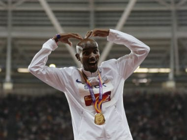 Britain's Mo Farah poses after winning the 10,000m race in London. AFP