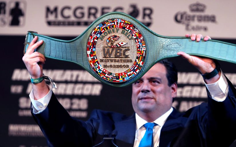 "WBC President Mauricio Sulaiman holds up the ""Money Belt"" during a news conference with undefeated boxer Floyd Mayweather and UFC lightweight champion Conor McGregor in Las Vegas. Reuters"