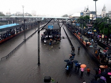 Commuters stranded at Thane railway station. PTI