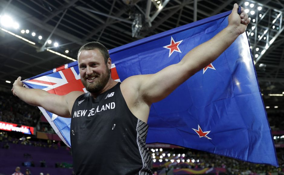 New Zealand's Tomas Walsh celebrates after winning the gold medal in the men's shot put final during the World Athletics Championships in London on Sunday. AP
