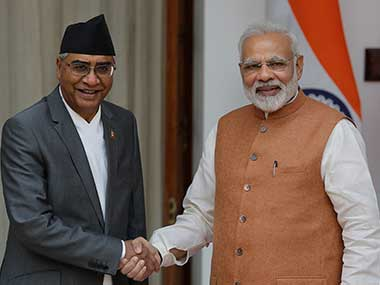 Prime Minister Narendra Modi shakes hands with his Nepalese counterpart Sher Bahadur Deuba before their meeting in New Delhi. AP