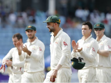Teammates congratulate Australia's Nathan Lyon, center, after he took six Bangladeshi wickets during the third day of their first test cricket match in Dhaka. AP