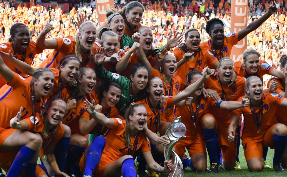 Players of the Netherlands celebrate with the trophy after defeating Denmark at the Women's Euro 2017 final. The sight of the victorious players dancing on the pitch after the final whistle of a memorable final added a new celebratory chapter to this football-loving country. AP
