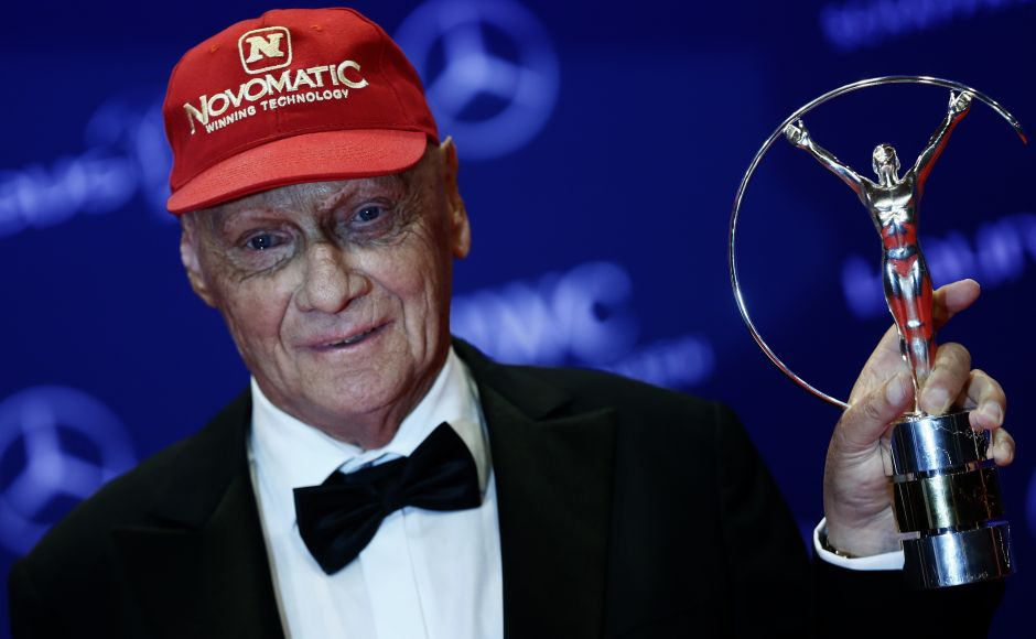 Former Formula One racer Niki Lauda poses with his Lifetime award at the Laureus World Sports Awards 2016. Reuters