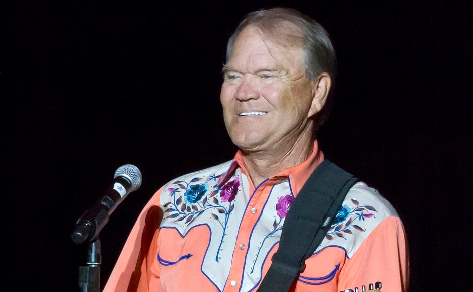 FILE - This 6 September, 2012 file photo shows singer Glen Campbell performing during his Goodbye Tour in Little Rock, Ark. Campbell, the grinning, high-pitched entertainer who had such hits as 'Rhinestone Cowboy' and spanned country, pop, television and movies, died Tuesday, 8 August, 2017. He was 81. Campbell announced in June 2011 that he had been diagnosed with Alzheimer's disease. (AP Photo/Danny Johnston, File)