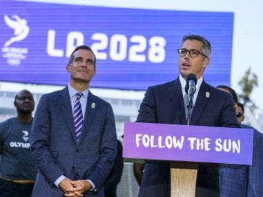 Mayor Eric Garcetti listens as LA Olympic Committee leader Casey Wasserman speaks during a press conference. AP