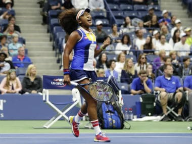Naomi Osaka celebrates during her first round clash against Angelique Kerber. AP