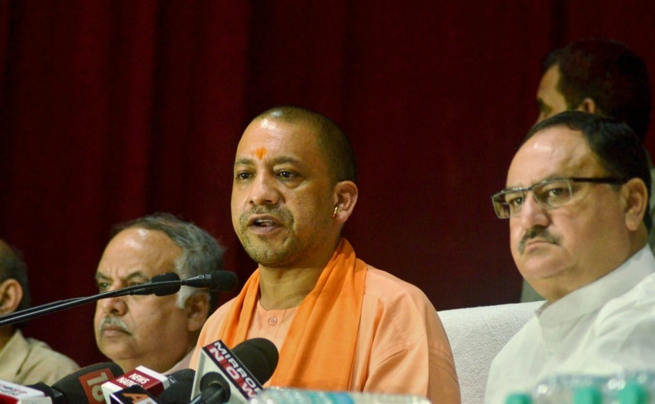 Uttar Pradesh chief minister Yogi Adityanath and Union health minister JP Nadda during a press conference after visiting BRD Medical College in Gorakhpur on Sunday. PTI