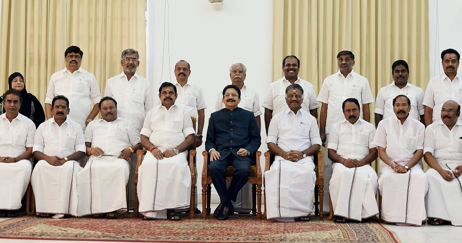 Governor CH Vidyasagar Rao and Chief Minister K Palaniswamy with newly sworn-in Dy CM O Panneerselvam and new ministers at Raj Bhavan in Chennai on Monday. VK Sasikala's removal seems to be on the cards as prior to the merger announcement, the Palaniswamy faction was expected to pass a resolution against the AIADMK general secretary.