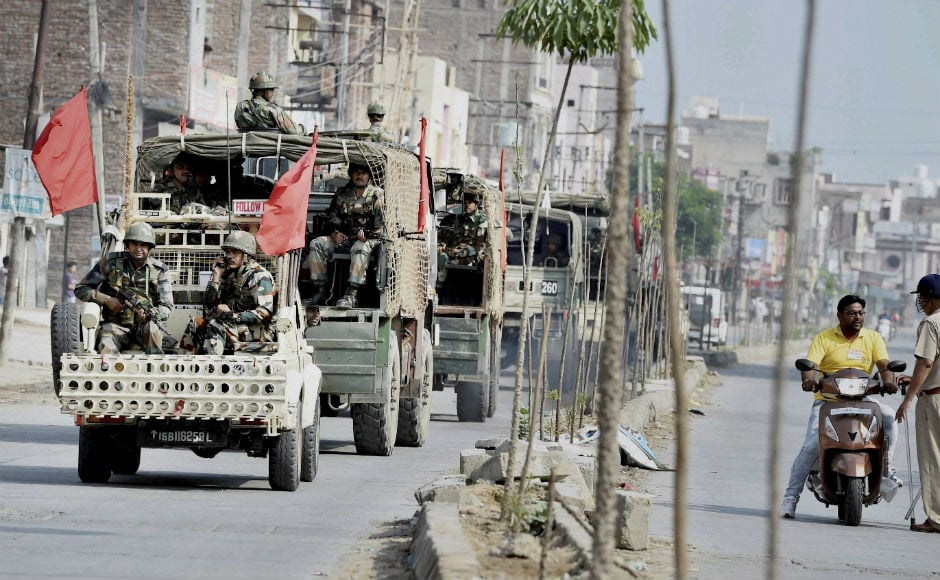 "Army forces can be seen conducting a flag march in Panchkula, the epicenter of Friday's violence. Security forces remained on high alert on Saturday. Haryana DGP BS Sandhu said that the situation is ""totally under control"". Police have detained 550 Dera Sacha Sauda supporters and confiscated 65 vehicles. PTI"