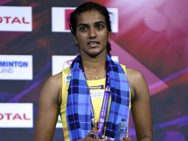 PV Sindhu poses with her silver medal on the podium after her defeat to Nozomi Okuhara. AFP