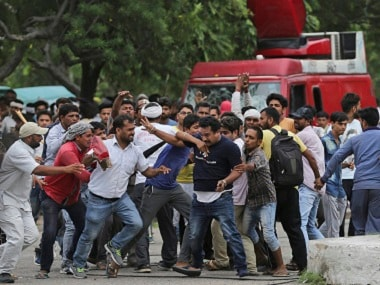 Supporters of the Dera Sacha Sauda sect attack a member of the media in Panchkula on Friday. PTI