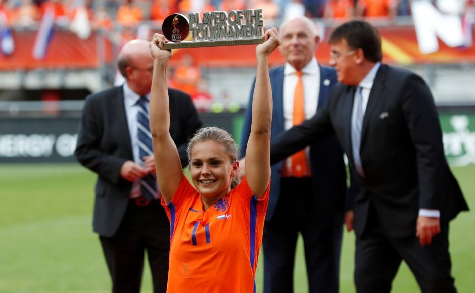 Netherlands' Lieke Martens celebrates with player of the tournament trophy. Reuters