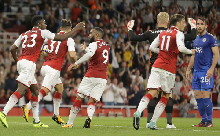 Arsenal's Danny Welbeck had the last word of the first half for the home side when he equalised from close range in added time. Welbeck, left, is congratulated by teammate Alexandre Lacazette after he scored his side's second goal of the game. AP