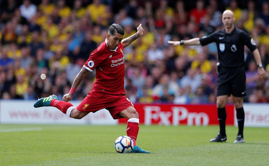 Liverpool's forward Roberto Firmino made no mistake from the spot as he sent Heurelho Gomes the wrong way and Liverpool were level again at 2-2. Reuters