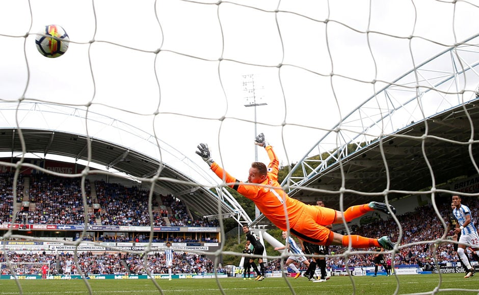 After a goal less first half, Huddersfield Town's Aaron Mooy scored a screamer past Rob Elliot for the first goal of the game in the 50th minute, which turned out to be the only goal of the match.Reuters