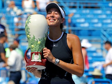 Aug 20, 2017; Mason, OH, USA; Garbine Muguruza (ESP) holds the Rookwood Cup after defeating Simona Halep (ROU) in the finals during the Western and Southern Open at the Lindner Family Tennis Center. Mandatory Credit: Aaron Doster-USA TODAY Sports TPX IMAGES OF THE DAY - RTS1CKE4