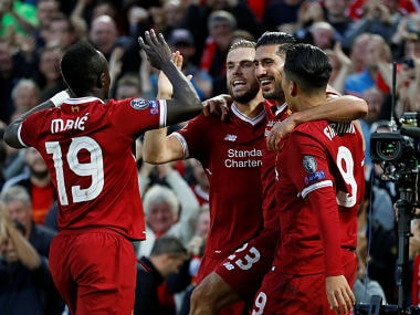 Football Soccer - Champions League - Playoffs - Liverpool vs TSG 1899 Hoffenheim - Liverpool, Britain - August 23, 2017 Liverpool's Emre Can celebrates scoring their first goal with team mates Action Images via Reuters/Carl Recine - RTS1D13A