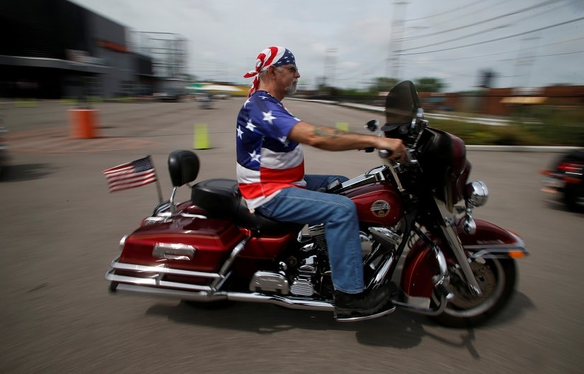 These are white men who live in America's sinks of economic duress — in mining towns where people lost jobs during or after the 2008 crash. Seen here A rider departs for a Bikers for Trump rally in Cleveland, Ohio, U.S., July 18, 2016. REUTERS/Jim Urquhart - RTSIK26