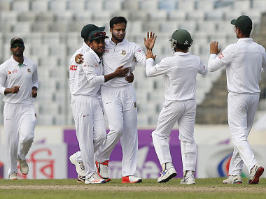 Cricket - Bangladesh v England - Second Test cricket match - Sher-e-Bangla Stadium, Dhaka, Bangladesh - 30/10/16. Bangladesh's Shakib Al Hasan (C) is congratulated by his teammates after taking the wicket of England's Joe Root. REUTERS/Mohammad Ponir Hossain - RTX2R14S