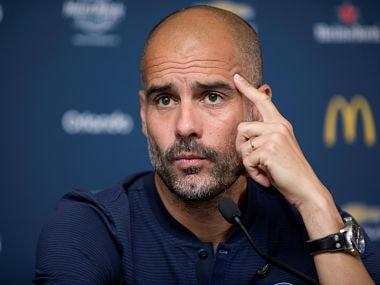 Football Soccer - Manchester City news conference - Houston, Texas, U.S. - July 19, 2017 - Manchester City's Manager Pep Guardiola waits to answer a reporter's question during a news conference. REUTERS/Daniel Kramer - RTX3C444