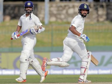 India's Ajinkya Rahane, left, and Cheteshwar Pujara run between the wickets during their second cricket test match against Sri Lanka in Colombo, Sri Lanka, Thursday, Aug. 3, 2017. (AP Photo/Eranga Jayawardena)