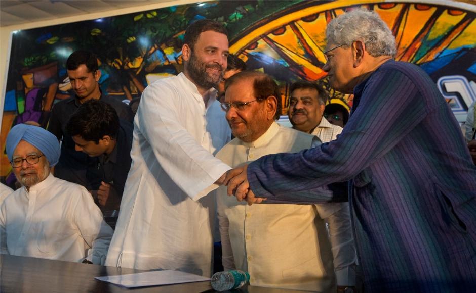 Rahul Gandhi shakes hand with Sitaram Yechury. Gandhi launched a scathing attack on the Rashtriya Swayamsevak Sangh (RSS) and the Narendra Modi government. AP