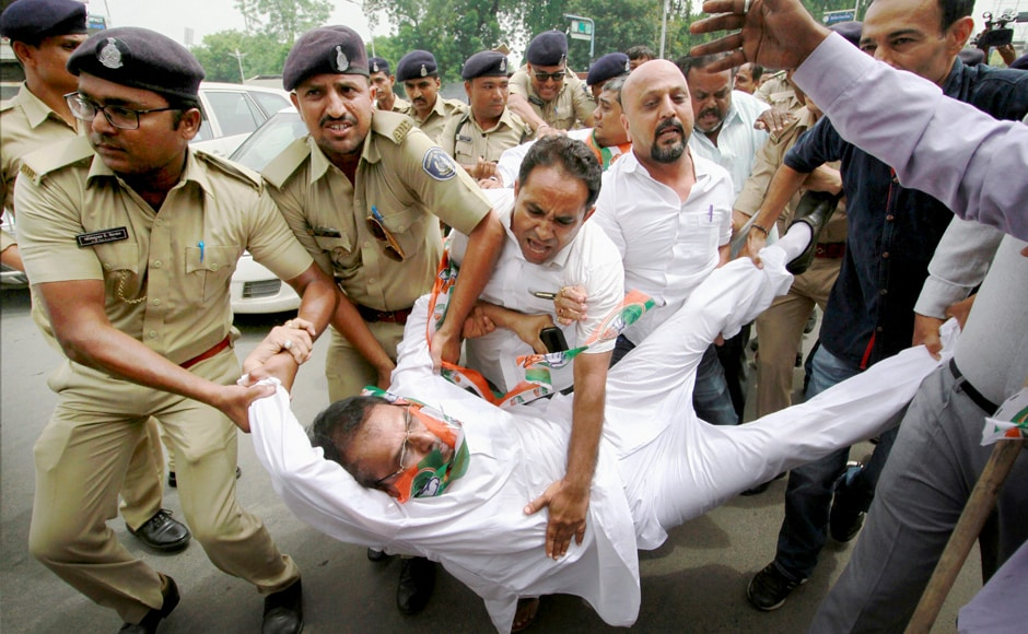 Police detain supporters of the Congress party, who were protesting against the alleged attack on Rahul Gandhi's car in Banaskantha district, in Ahmedabad on Saturday. Supporters protested against the incident in various parts of the country. PTI