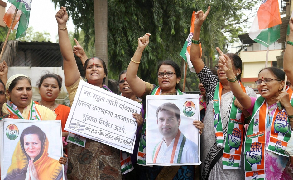 Congress party workers stage a demonstration in Mumbai on Saturday. Talking to reporters, the Congress vice-president said that a BJP worker flung stones at his convoy. PTI