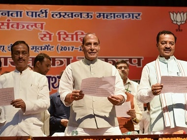 Rajnath Singh administering the oath in the Lucknow event. PTI