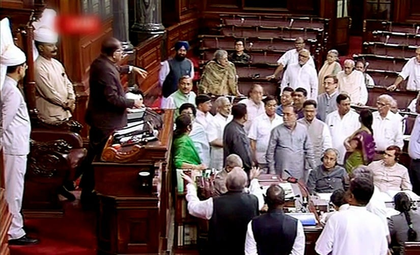 Congress MPs are seen in the Well of the Rajya Sabha during the ongoing monsoon session of Parliament, in New Delhi on Wednesday. PTI