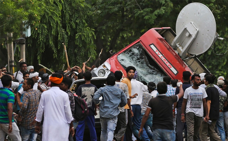 Enraged by the rape conviction of self-styled godman Gurmeet Ram Rahim Singh on Friday, his followers went on the rampage, hurling stones and vandalising media vehicles. At least three outdoor broadcast vans of private television channels were damaged. One van was overturned by a mob. AP