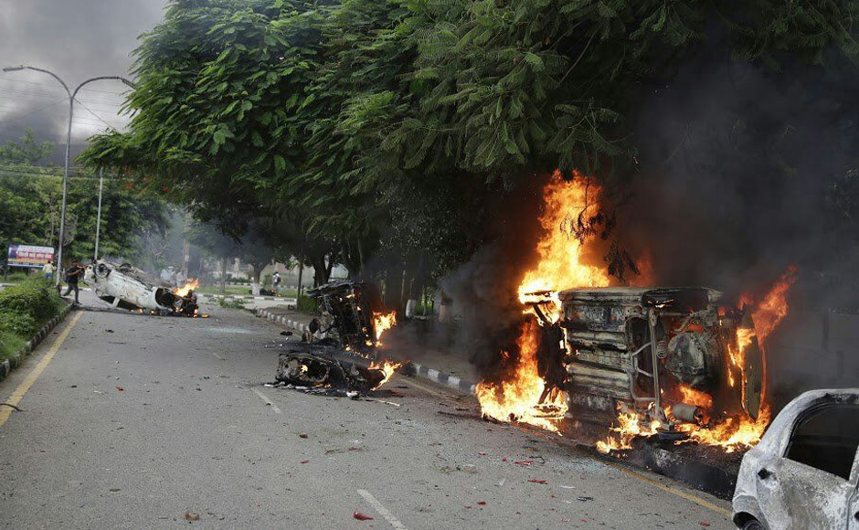 Nearly 200 people have been injured in the violence in Panchkula, Haryana. Buses, railway stations, fire engines and petrol pumps were set on fire by Dera Sacha Sauda supporters. Saurabh Sharma/ Firstpost