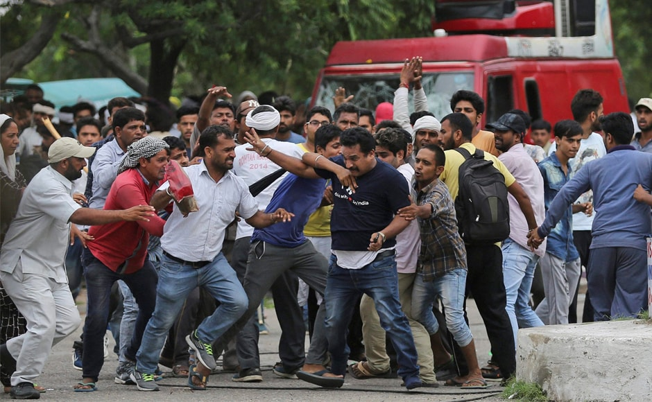 Dera supporters manhandle a mediaperson. Five people also attempted suicide as the clashes spread across Punjab, Uttar Pradesh and Delhi. PTI