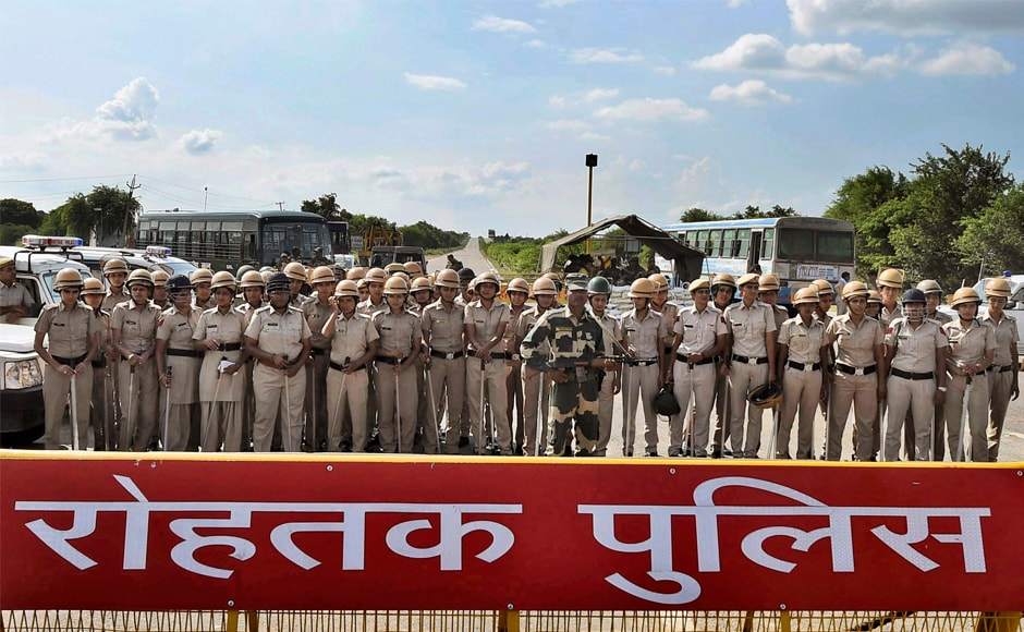 Security personnel keeping strict vigil near Sunariya Jail, where Dera Sacha Sauda chief Gurmeet Ram Rahim Singh's quantum of sentence was pronounced, in Rohtak on Monday. A special CBI court sentenced him to 20 years in prison for the two separate rape cases against him. PTI