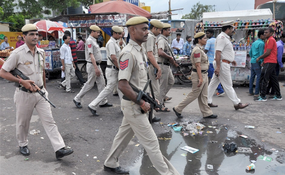Police personnel continued to keep a vigil near the New Delhi Railway Station on Monday. Several places have been kept under curfew and prohibitory orders even after the sentence was announced. PTI