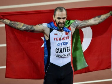 Turkey's Ramil Guliyev celebrates after winning the men's 200 meters final at the World Athletics Championships in London. AP