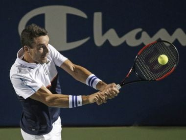 Roberto Bautista Agut, of Spain, returns a shot against Jan-Lennard Struff, of Germany, during a semifinal of the Winston-Salem Open tennis tournament in Winston-Salem, N.C., Friday, Aug. 25, 2017. (AP Photo/Chuck Burton)