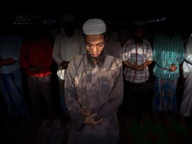 Rohingya refugees pray at their slum on the outskirts of New Delhi, India. An estimated 40,000 Rohingya Muslims have taken refuge in various parts of India, though fewer than 15,000 are registered with the UN High Commissioner for Refugees. AP
