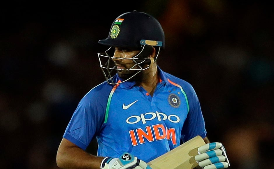 India's Rohit Sharma leaves the ground after Chamara Kapugedera run him out for a paltry 4. AP