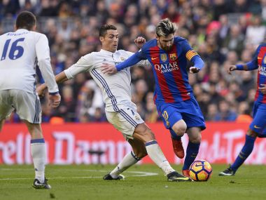 Cristiano Ronaldo (L) and Lionel Messi (R) in action. AFP