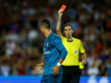 Cristiano Ronaldo shoved the referee after being show a second yellow for speculated simulation. Reuters