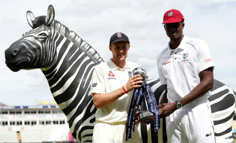 England captain Joe Root and West Indies' Jason Holder pose with the Test series trophy ahead of the day-night Test in Edgbaston. Reuters