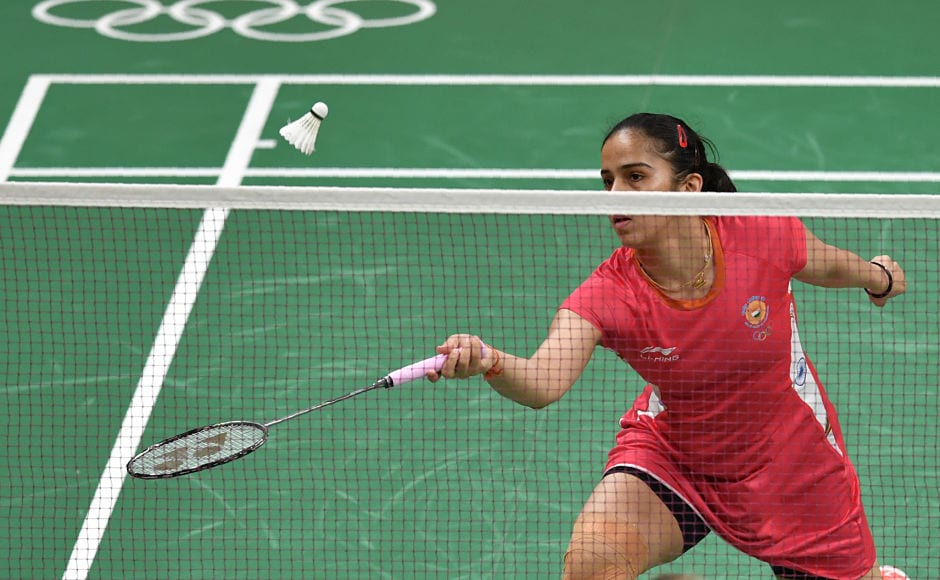 Saina Nehwal returns to Ukraine's Maria Ulitina during their women's singles match, winning the game in just 33 minutes. AFP