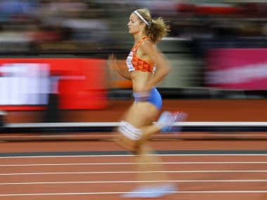 Athletics - World Athletics Championships - Women's 200 Metres Semi-Final - London Stadium, London, Britain – August 10, 2017. Dafne Schippers of the Netherlands wins the heat. REUTERS/Kai Pfaffenbach - RTS1B9B3