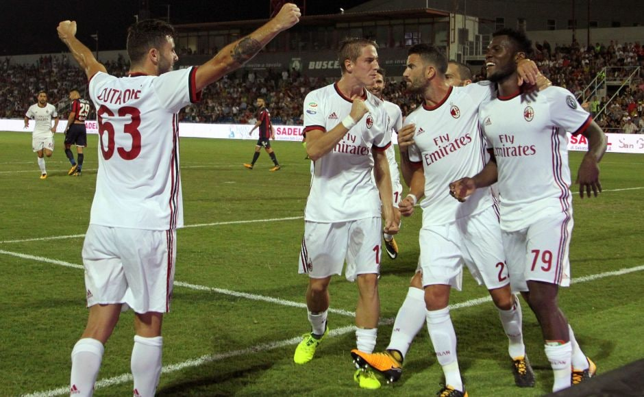 AC Milan's Frank Kessie (R) celebrates with teammates after scoring. After only four minutes, Federico Ceccherini brought down Patrick Cutrone and, after consulting with the VAR, the referee sent off the defender and awarded the visitors a penalty, which Franck Kessie converted for his first goal for his new club. AP