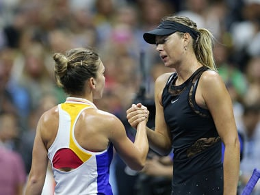 Maria Sharapova ) shakes hands with Simona Halep after their match on Monday. Reuters